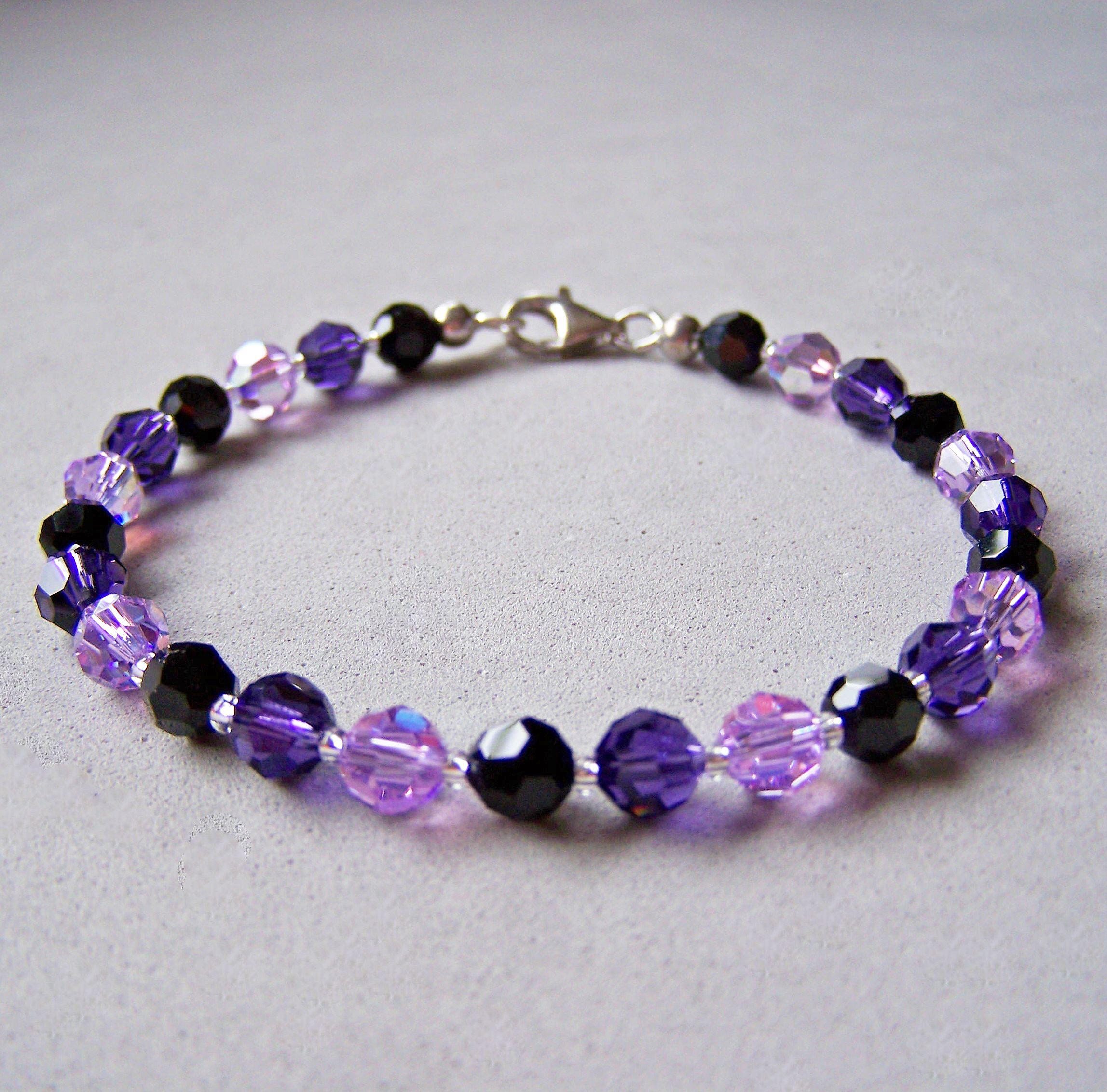 armband aus swarovski kristall perlen 6mm in lila. Black Bedroom Furniture Sets. Home Design Ideas