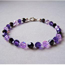Armband aus Swarovski® Kristallperlen 6mm in lila, violett und schwarz, Verschluss: 925 Silber
