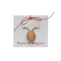 Nuss-Drängler mit einer Walnuss und roter Schnur
