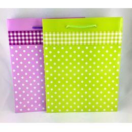 Geschenktüte mit fröhlichem Punktemuster für kleine Aufmerksamkeiten Maße:  23 x 18 x 10 cm