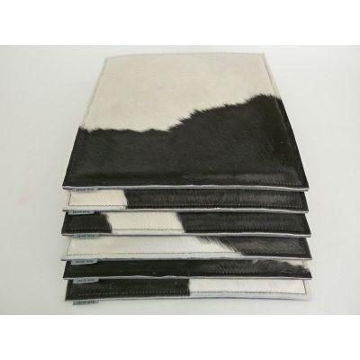 Sitzauflage Kuhfell in schwarz-weiß und Filz in - Hellblau F15 | 547480290