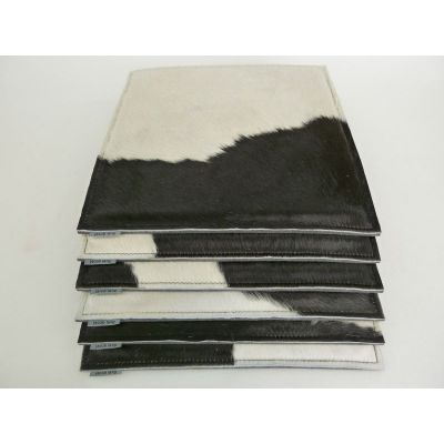 Sitzauflage Kuhfell in schwarz-weiß und Filz in - Orange F6 | 547480290